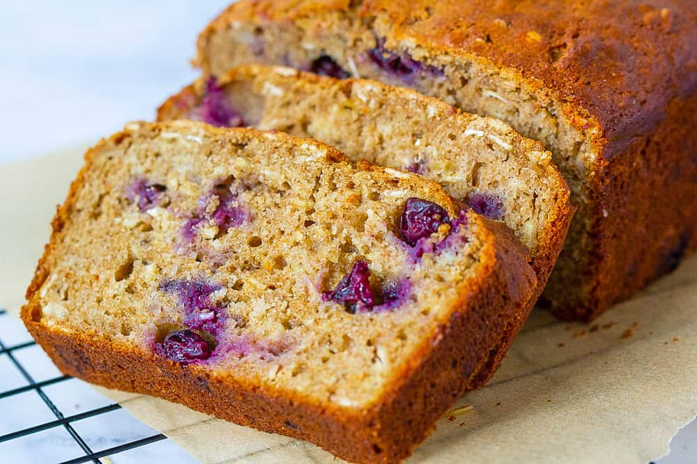 blueberry bread, sliced, on a cooling rack