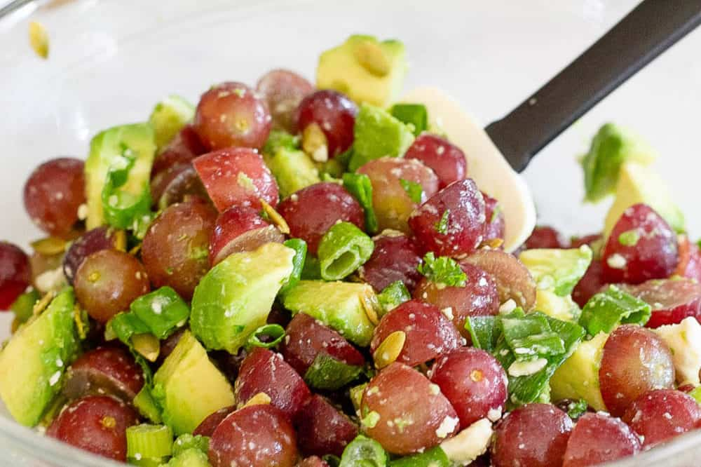 grapes and avocado tossed in a bowl