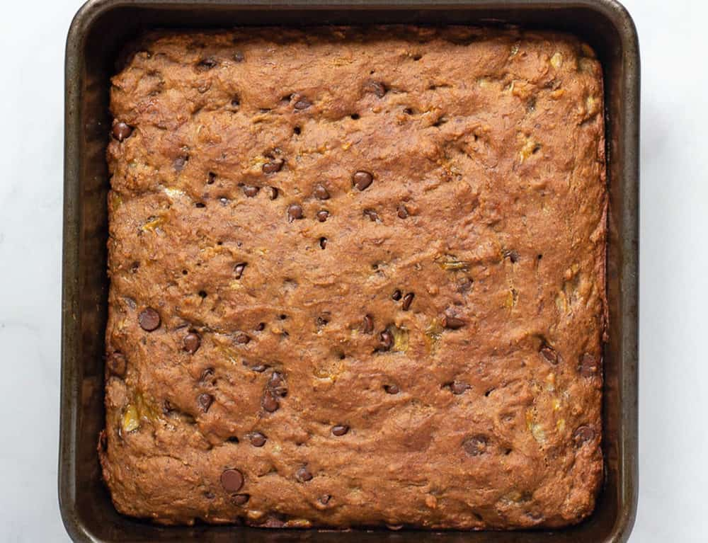 healthy chocolate chip banana bread fresh out of the oven in a baking dish