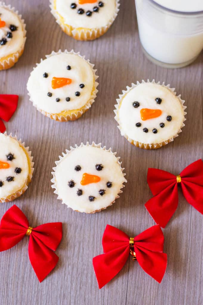 snowman cupcakes against a grey background