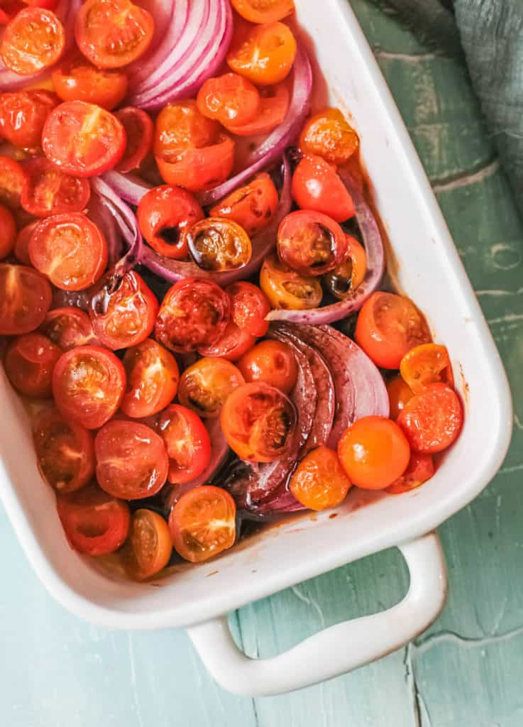 roasted tomatoes and onions in a baking dish