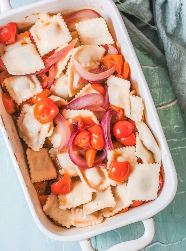 ravioli and toppings in a roasting pan