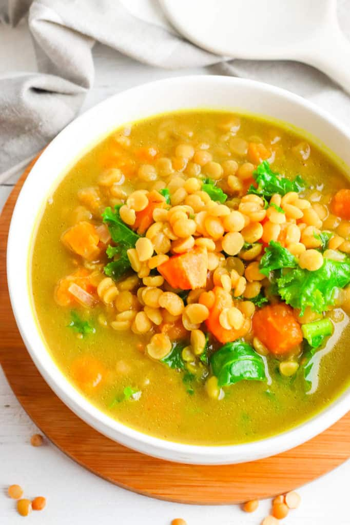 sweet potato dahl with kale, served in a white bowl