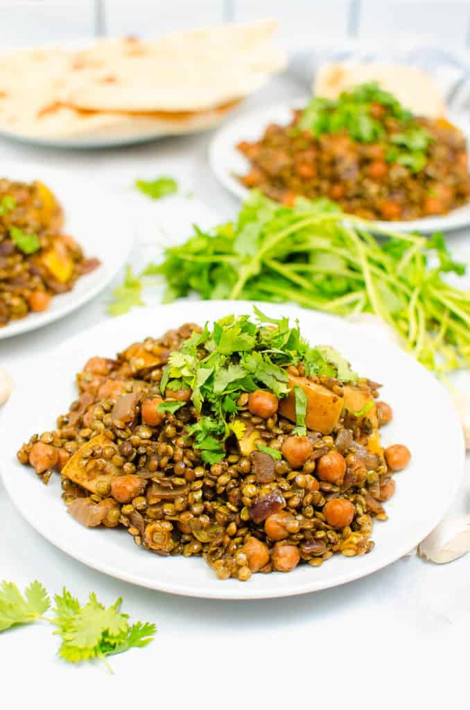 apple curry with lentils and chickpeas served on a white plate - vegetarian gluten free recipes