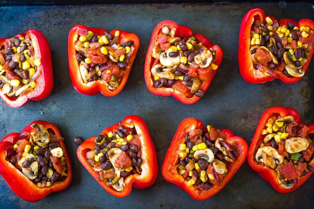 peppers stuffed ready to go into the oven (on a baking sheet)