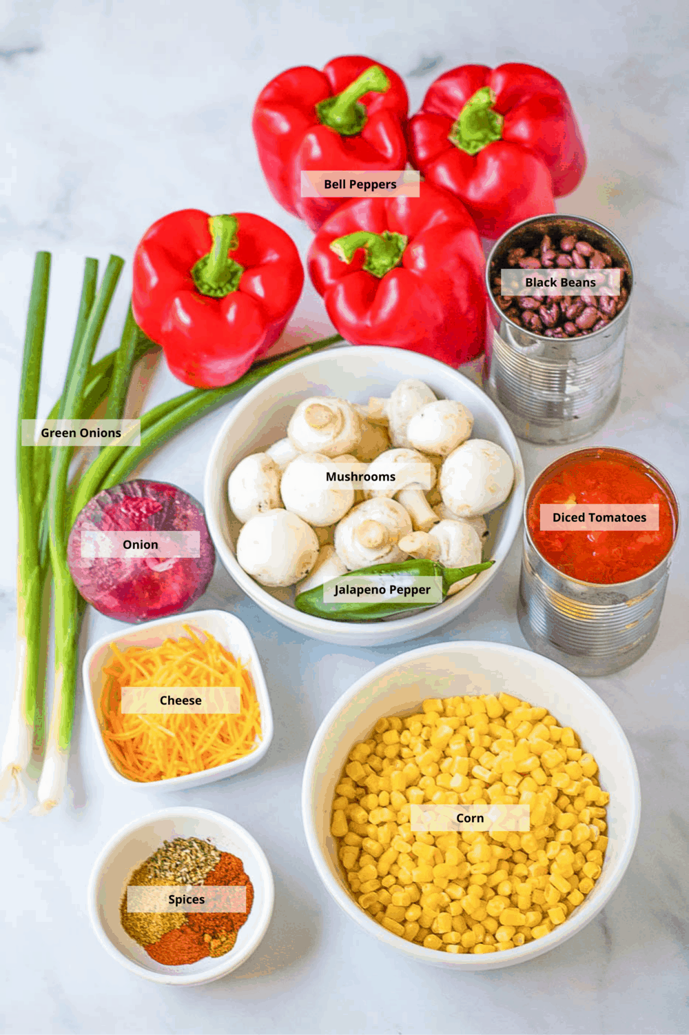 ingredients for chili stuffed peppers with black beans and mushrooms