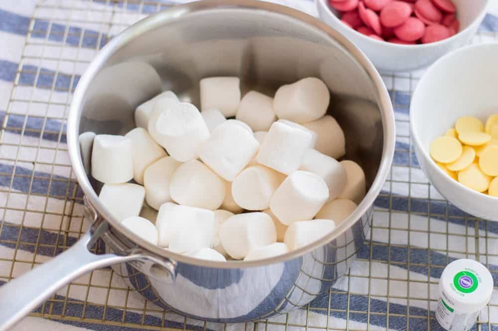marshmallows being melted in a pot