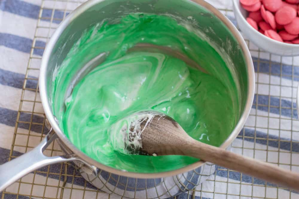 food coloring and marshmallows mixed in a pot