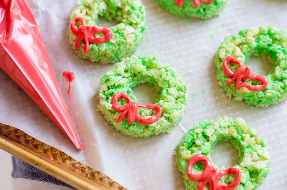 Christmas Rice Krispie Treats with Candy Ribbons on a baking sheet