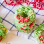 Christmas Rice Krispie Treats with Candy Ribbons against a blue and white background with holiday decorations