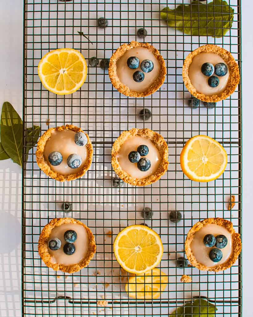Lemon Tartlets with Coconut Milk Filling on a wire rack