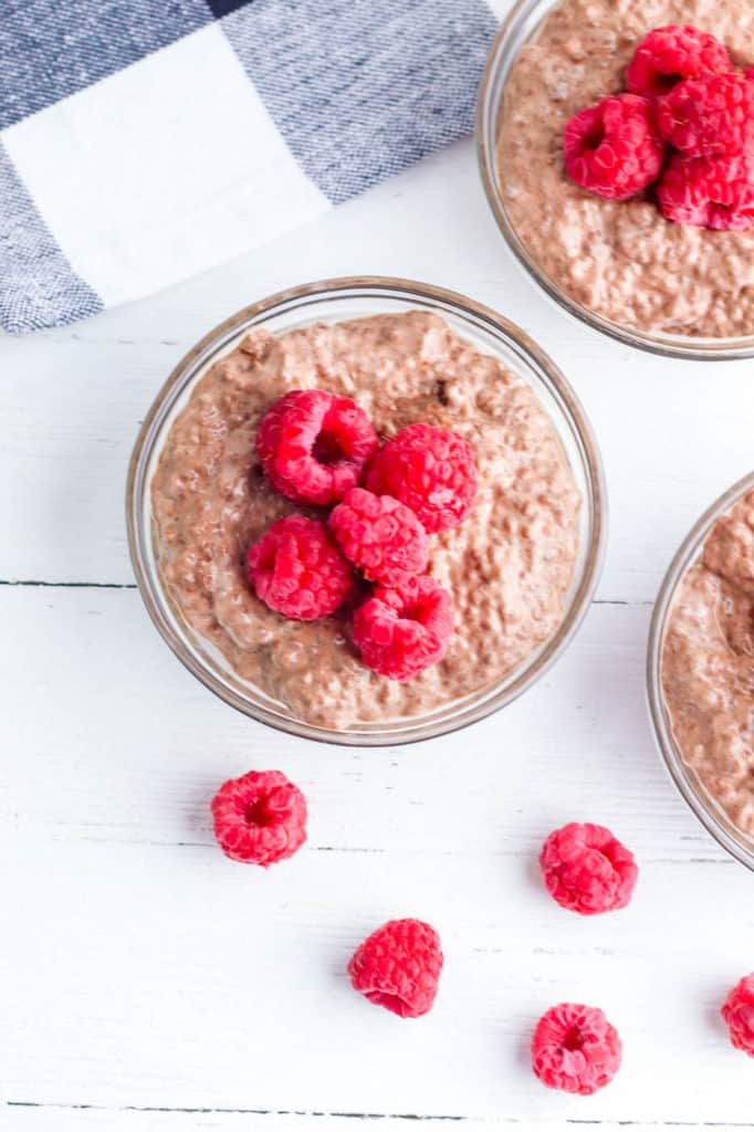 vegan chocolate mousse topped with raspberries