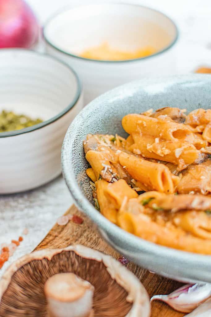 vegan mushroom stroganoff served in a blue bowl