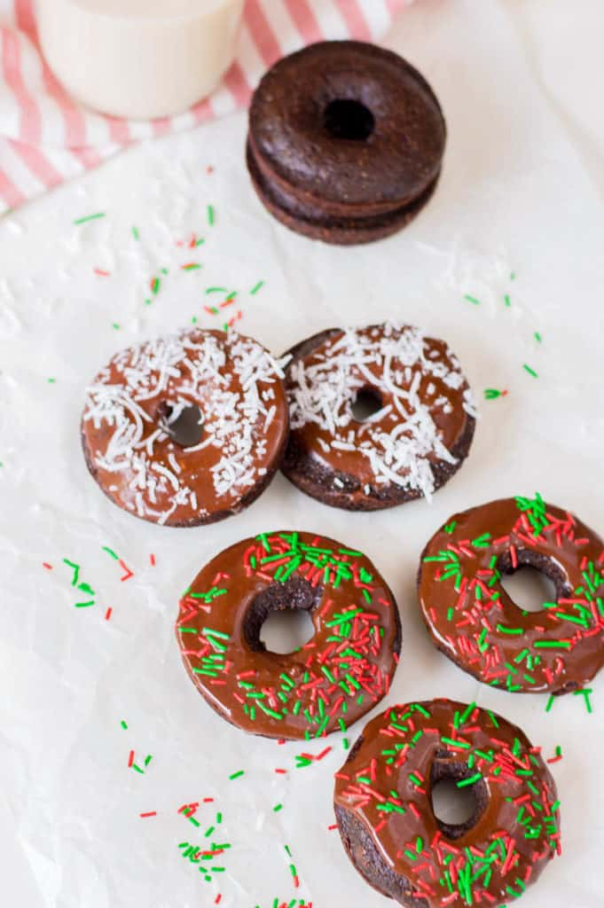 chocolate doughnuts with chocolate icing and sprinkles / coconut shreds