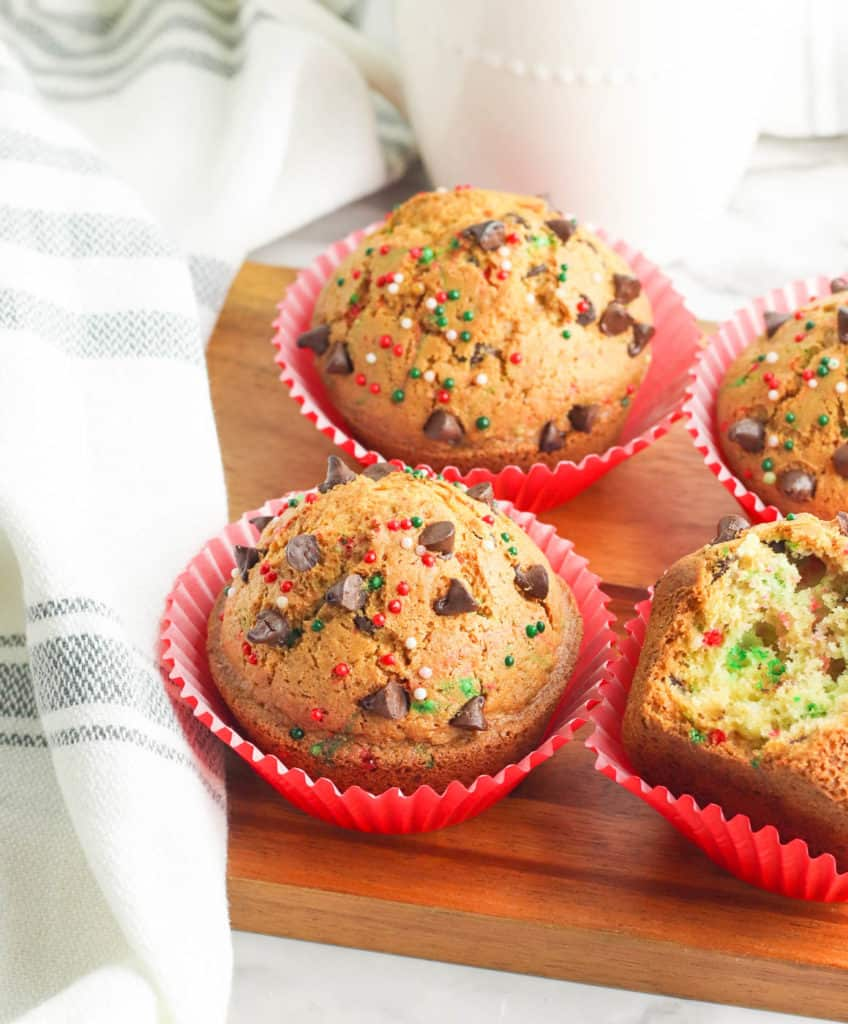 christmas muffins with chocolate chips on a wooden cutting board