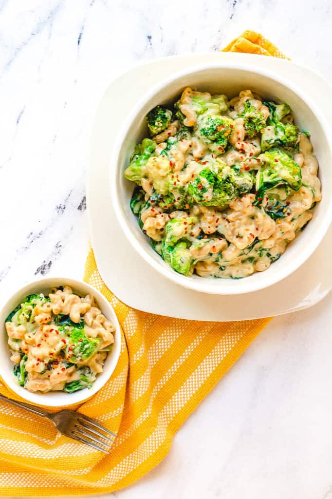 healthy mac and cheese with broccoli served in a white bowl