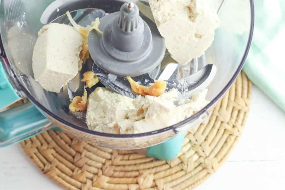 garlic and tofu in a food processor