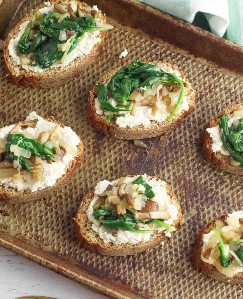spinach and mushrooms added to toast