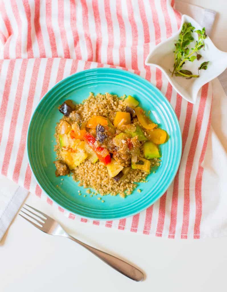 vegan ratatouille with seasonal vegetables in a blue bowl