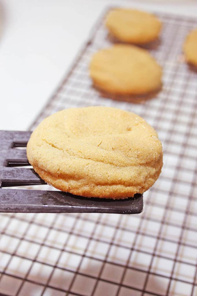 cookie on a spatula above a baking sheet