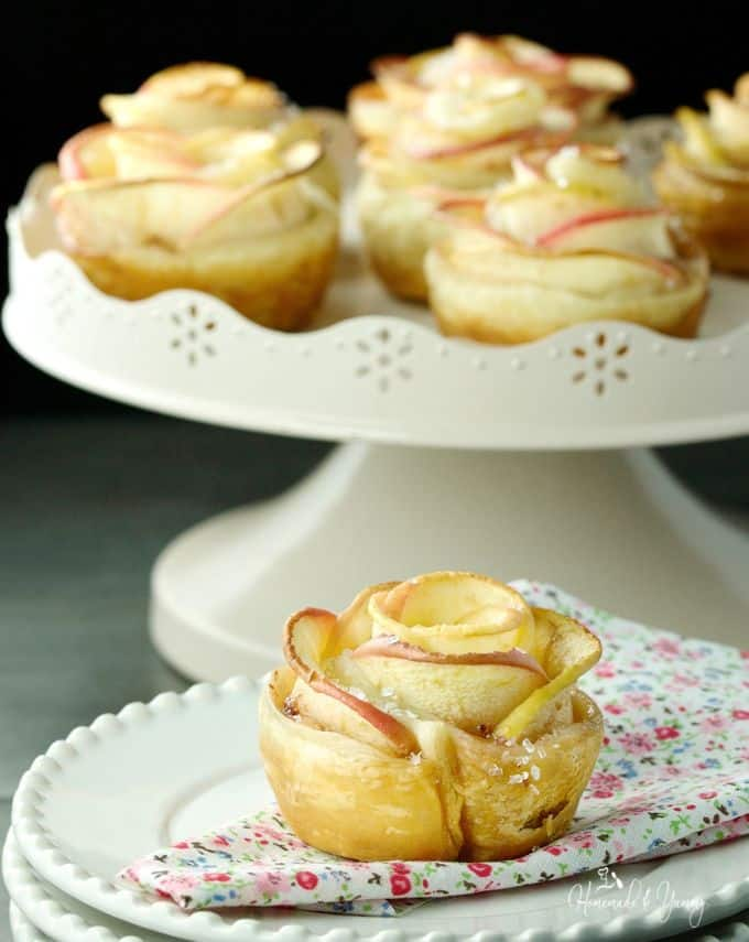 a romantic dessert of puff pastry apples in the shape of a rose