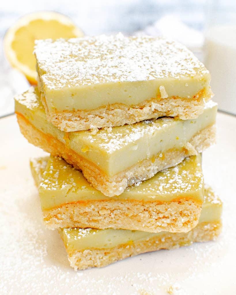 stacked gluten free lemon barson a white plate