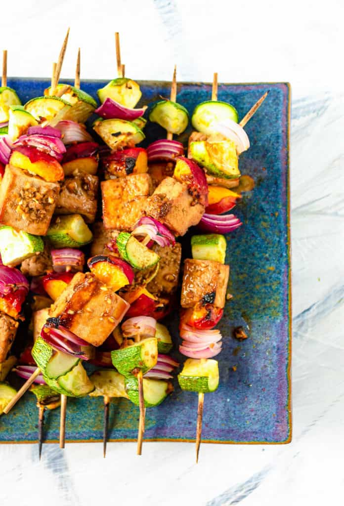 tofu skewers on a blue plate