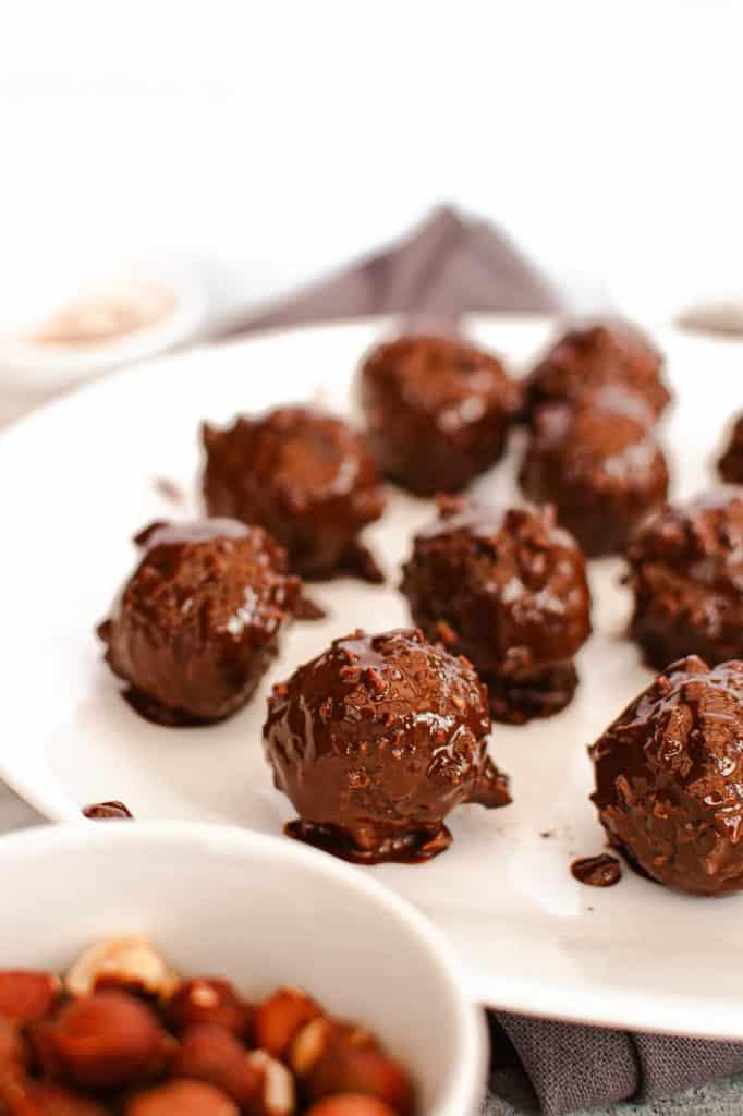 ferrero rocher recipe - hazelnut chocolate bites on a plate