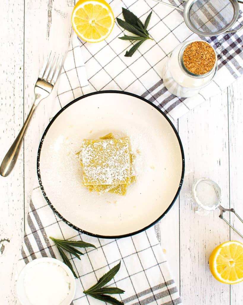 top view of vegan gluten free lemon bars on a white plate