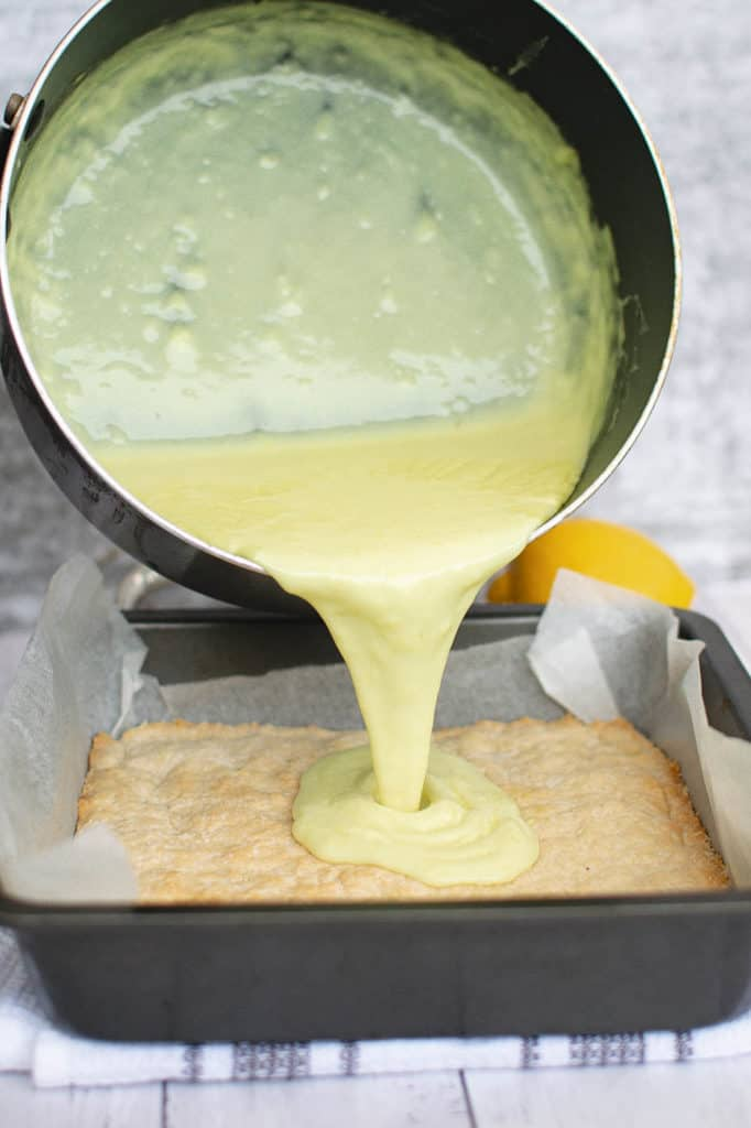 custard poured on top of crust in baking pan