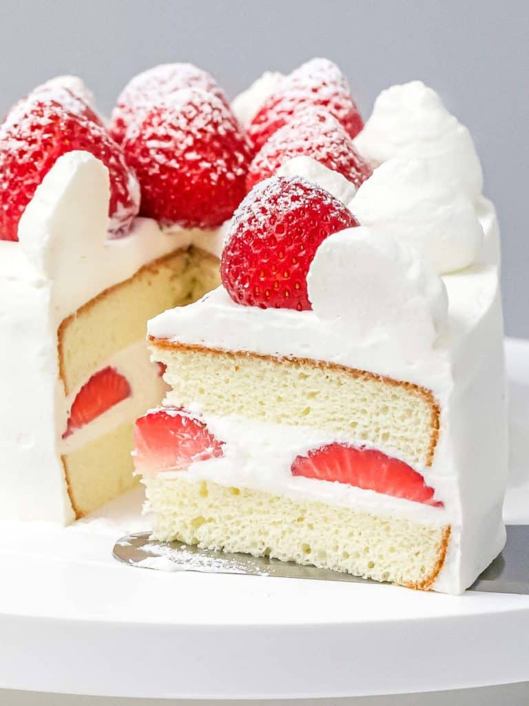 Japanese strawberry shortcake with whipped cream frosting and fresh strawberries