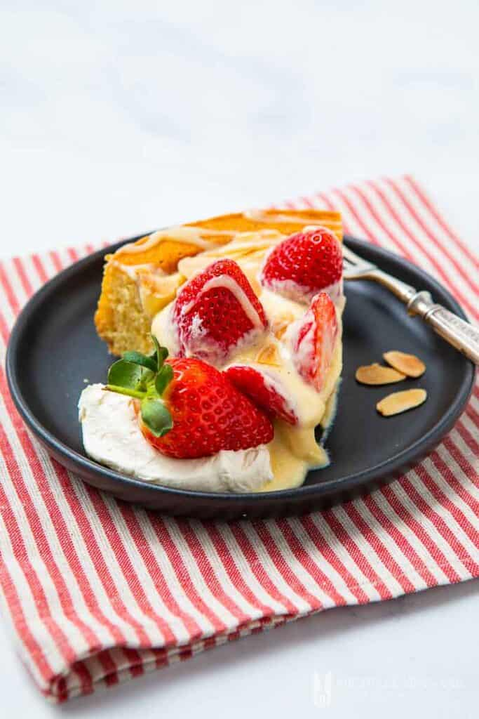 strawberry flan on black plate and striped kitchen towel - romantic desserts for two