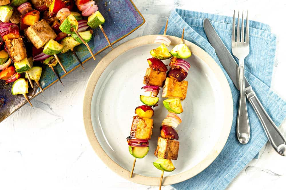finished tofu skewers on a white plate