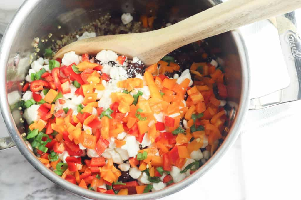 veggies added to a pot on the stovetop