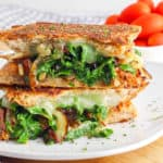 Kale and Caramelized Onion Veggie Panini Recipe on a white plate