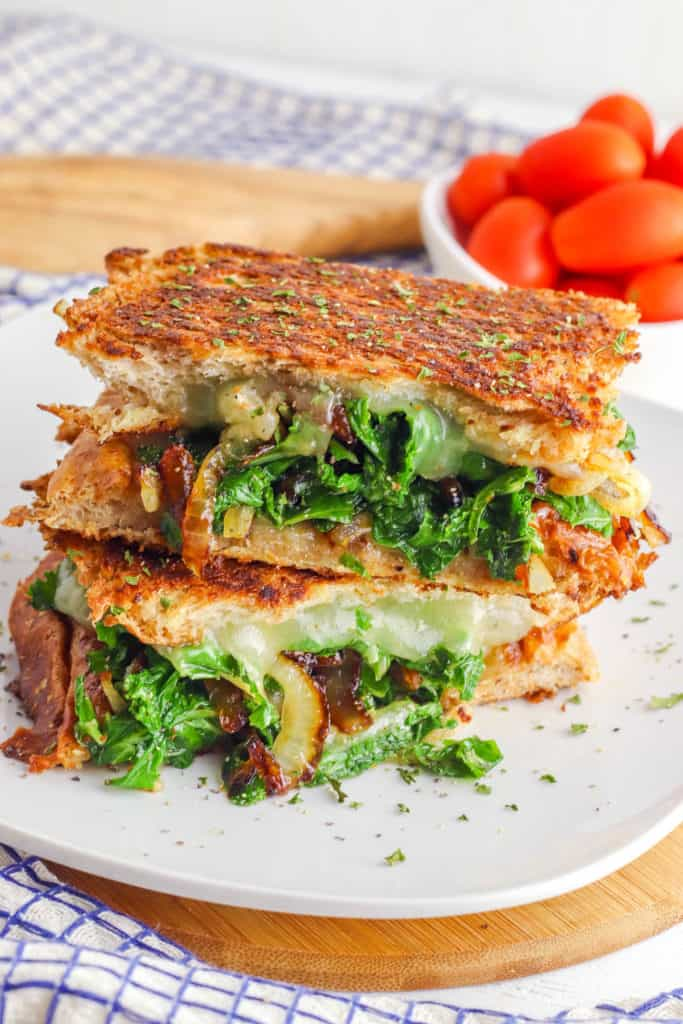Kale and Caramelized Onion Veggie Panini Recipe on a white plate