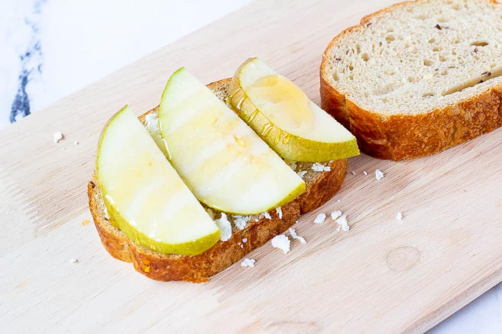 bread topped with cheese and pear