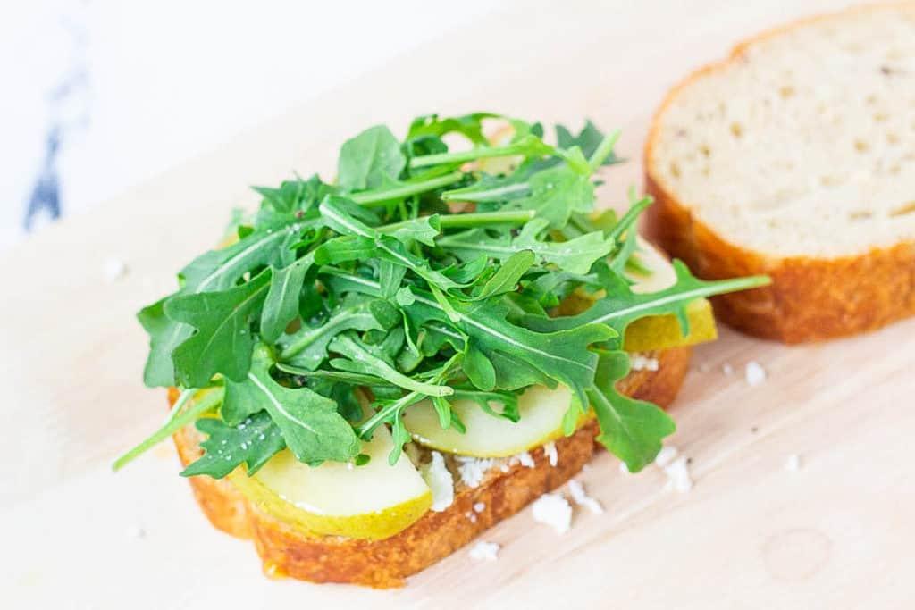 arugula and pear on bread