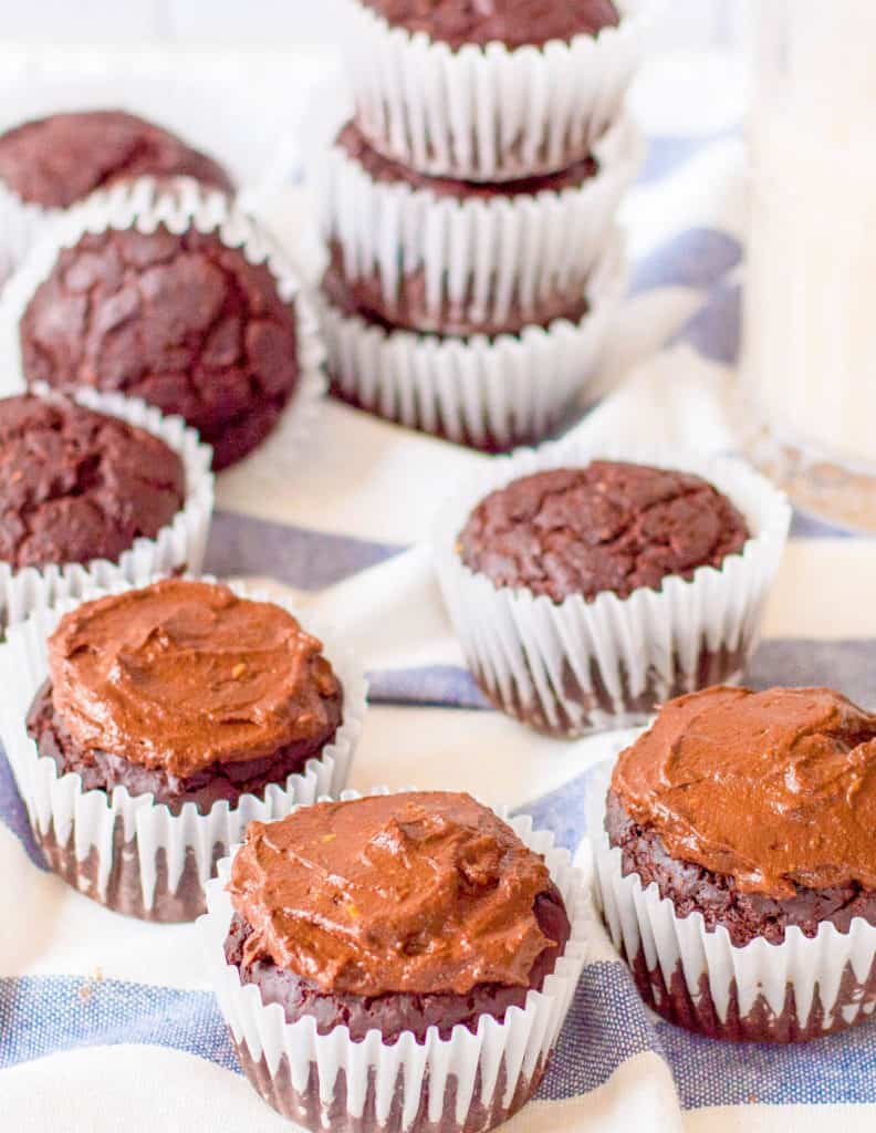 healthy chocolate cupcakes on a blue and white cloth