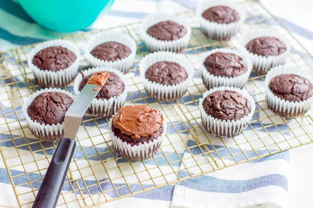 chocolate frosting added to healthy chocolate cupcakes