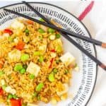 tofu friend rice on plate with chop sticks