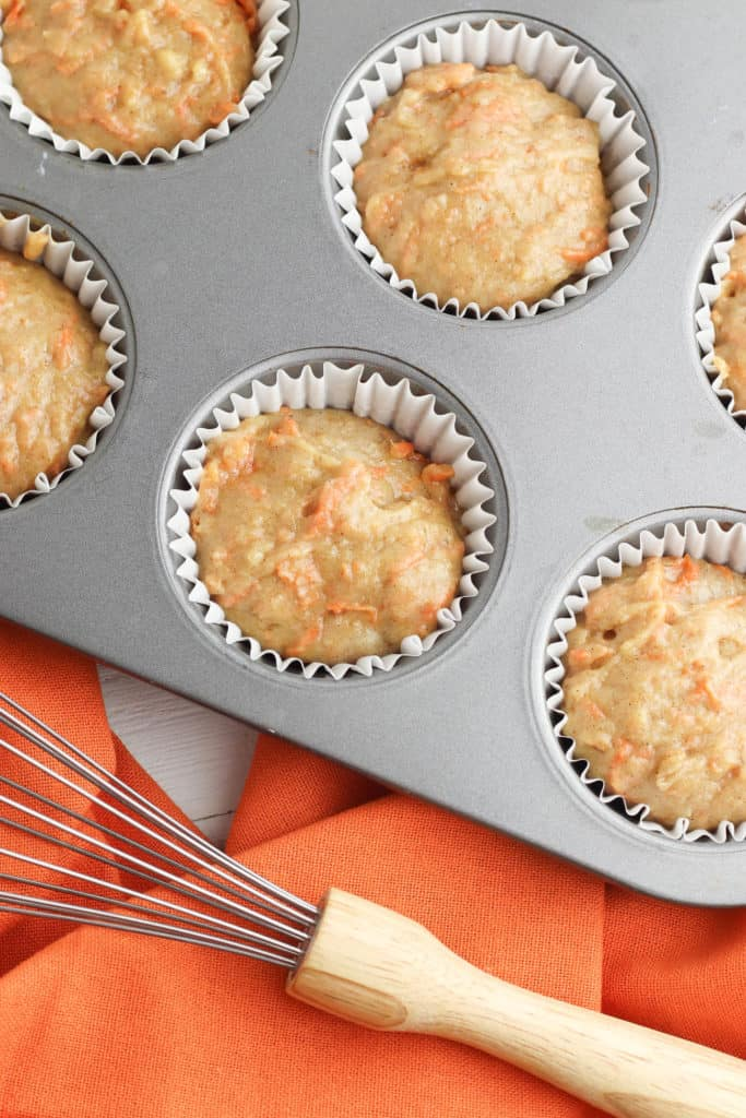 carrot cake cupcake batter added to muffin tins