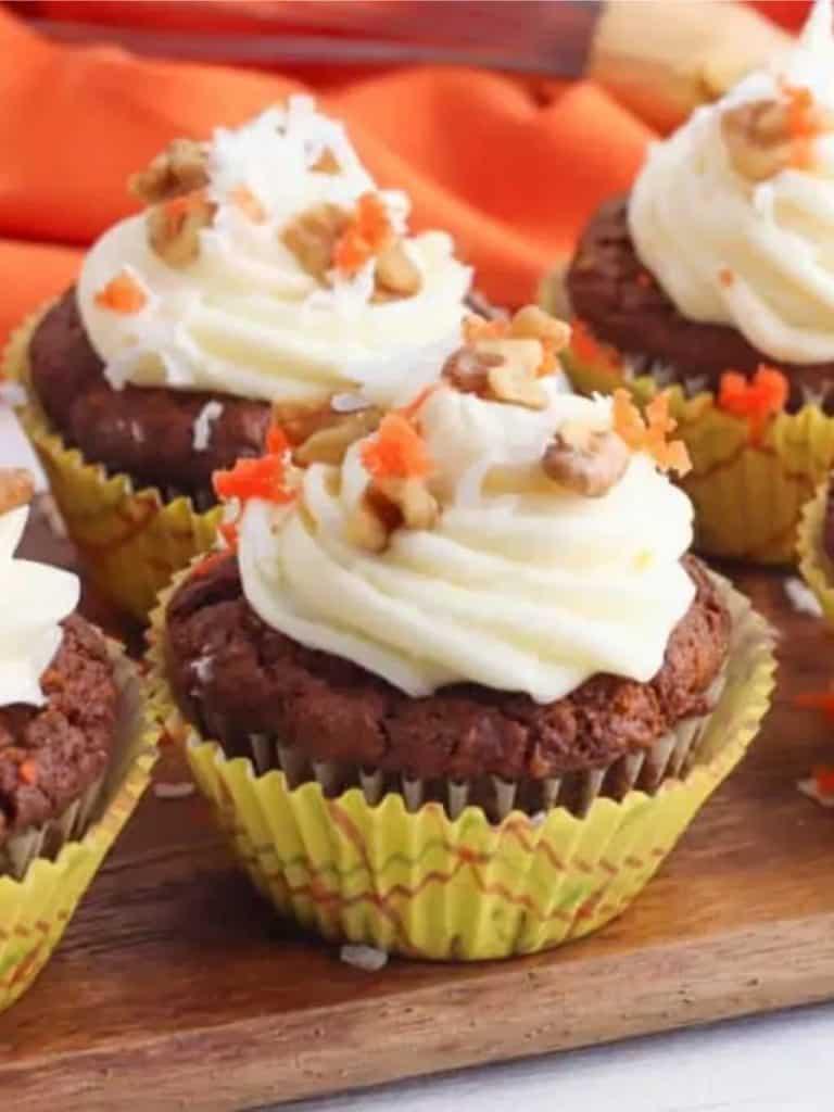 vegan carrot cake cupcakes on wood serving tray