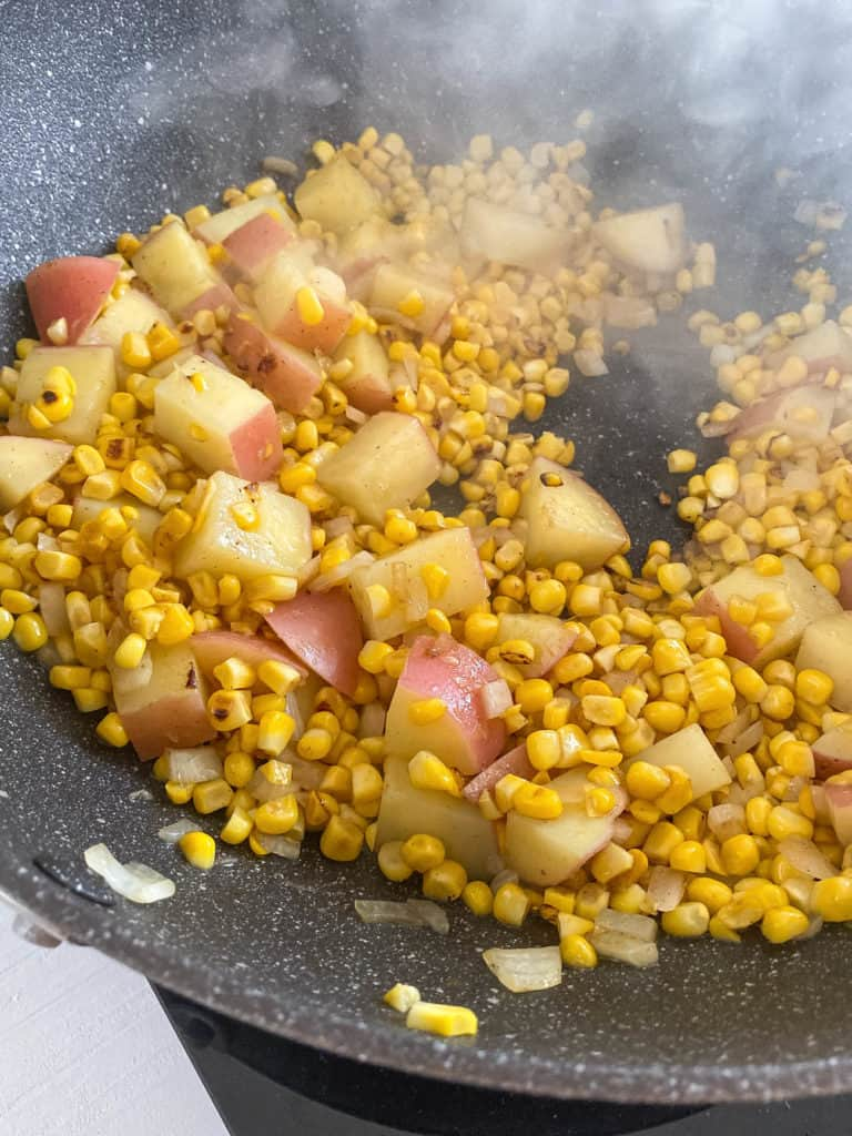 potatoes and corn in a pot