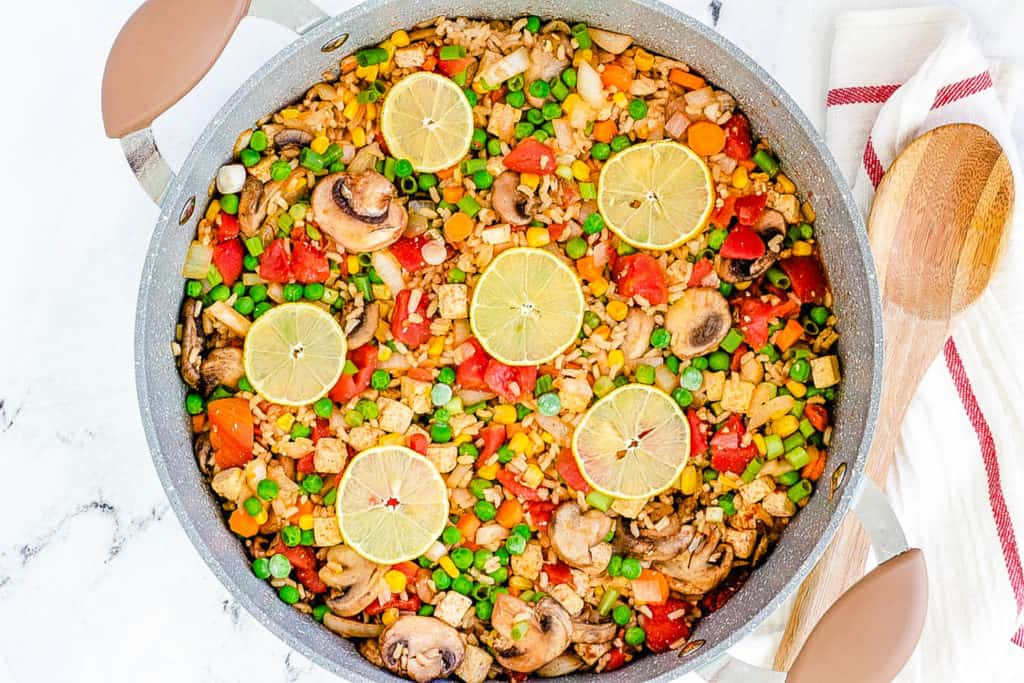 vegan paella with tofu served in a large skillet