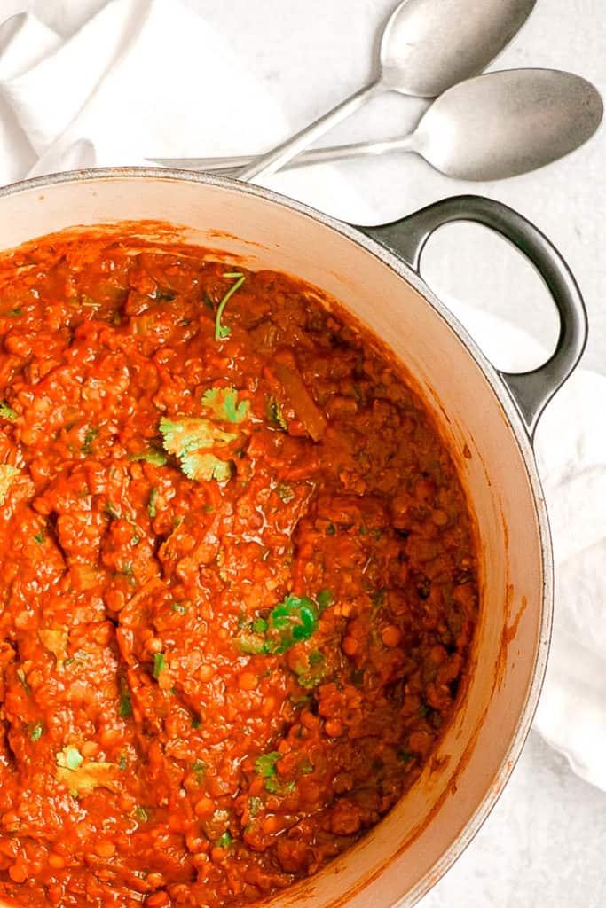 red lentil dal cooking in a pot