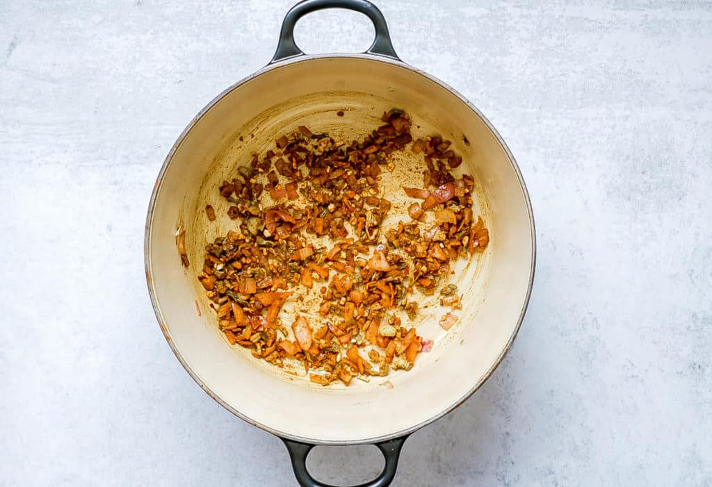 onions, celery and spices sauteeing in a pot