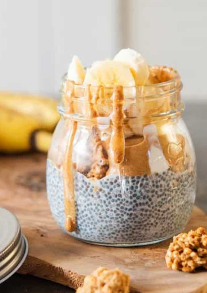 jar of chia pudding topped with peanut butter and bananas