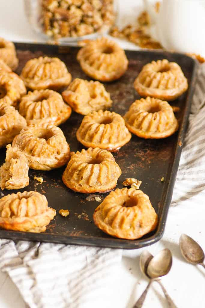 mini bundt cakes with banana and walnuts, served on a baking sheet