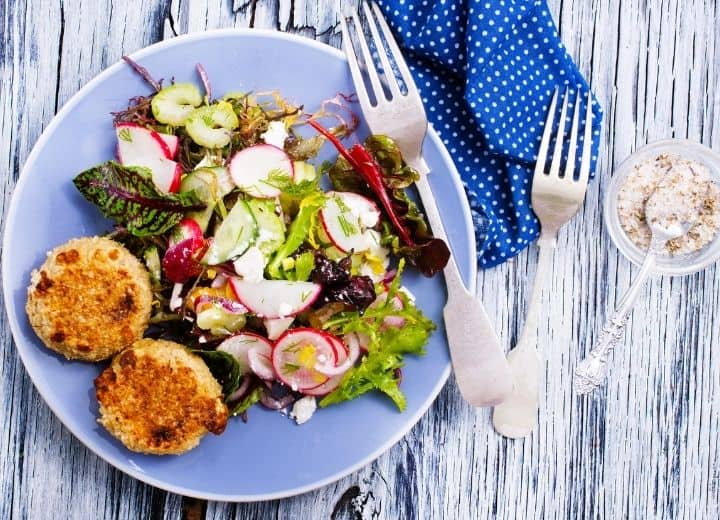 healthy small meals, salad and chickpea cakes on blue plate